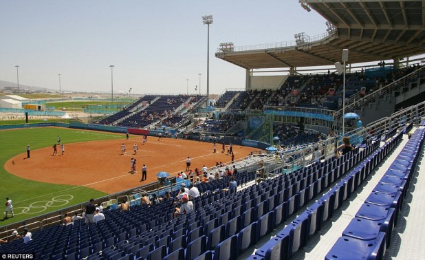 At the 2004 Athens Games baseball pitch, the chairs were a vibrant blue and the pitch was covered with lush green grass