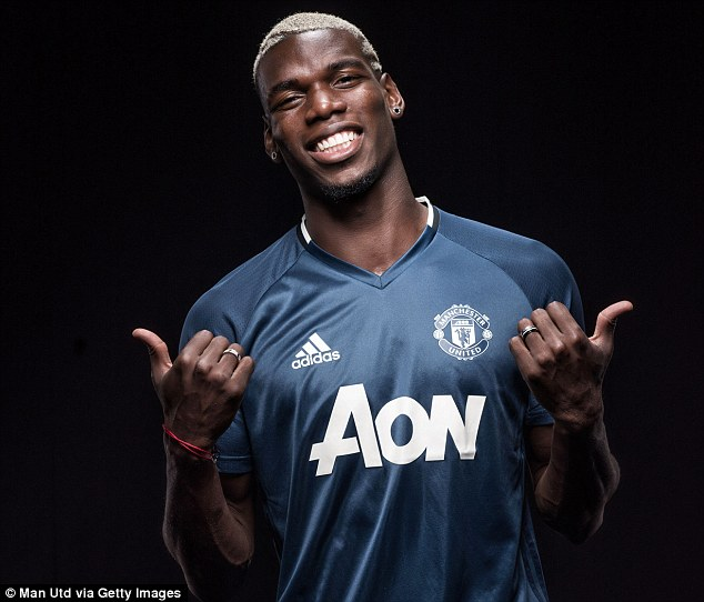 The former Juventus midfielder poses in United gear after sealing his £100m transfer