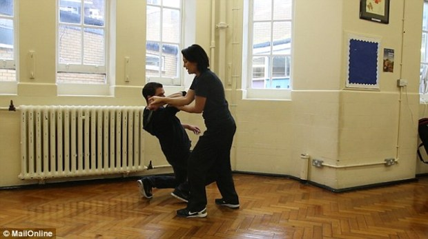 Dalia strikes the man in the elbow joint, which causeshis arm to buckle and fold, enabling her to push it backwards and move the weapon away from her body