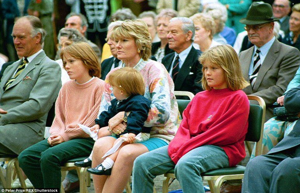 Hugh as a young boy with his mother Natalia, and sisters Lady Edwina and Lady Tamara  as they listen to a speech made by their father in 1992
