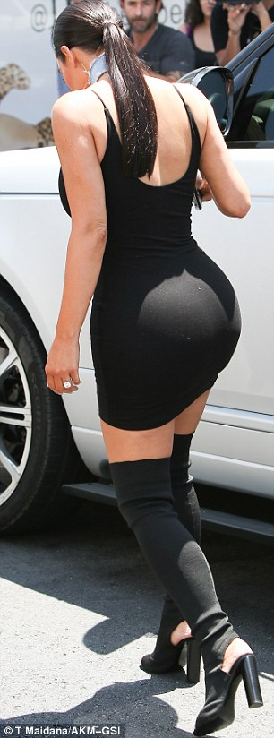 Konfident! Kim Kardashian stepped out LA wearing a LBD and custom Yeezy thigh-high boots on Wednesday