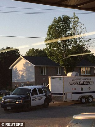 Police raided a home after they received 'credible information of a potential terrorist threat'