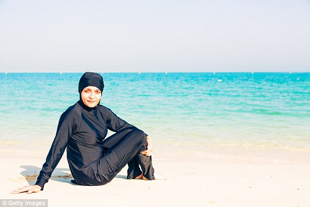 Cannes officials say they are banning the burkini because it is a 'symbol' of Islamist extremism (pictured, a file photo of a woman wearing the swimwear)