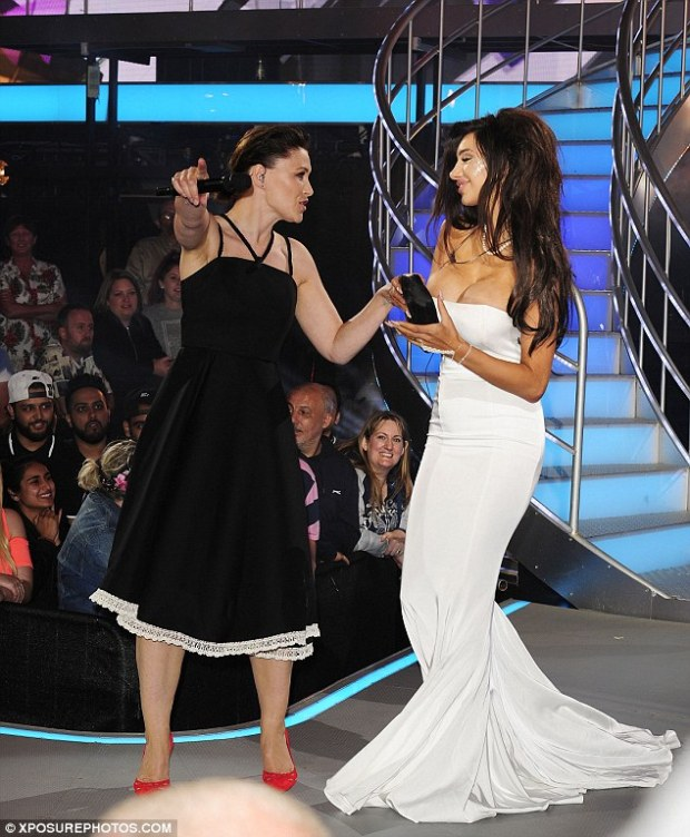Contrast: Emma Willis' demure little black dress was the opposite of Chloe's revealing white gown in every way as the pair chatted at the bottom of the stairs