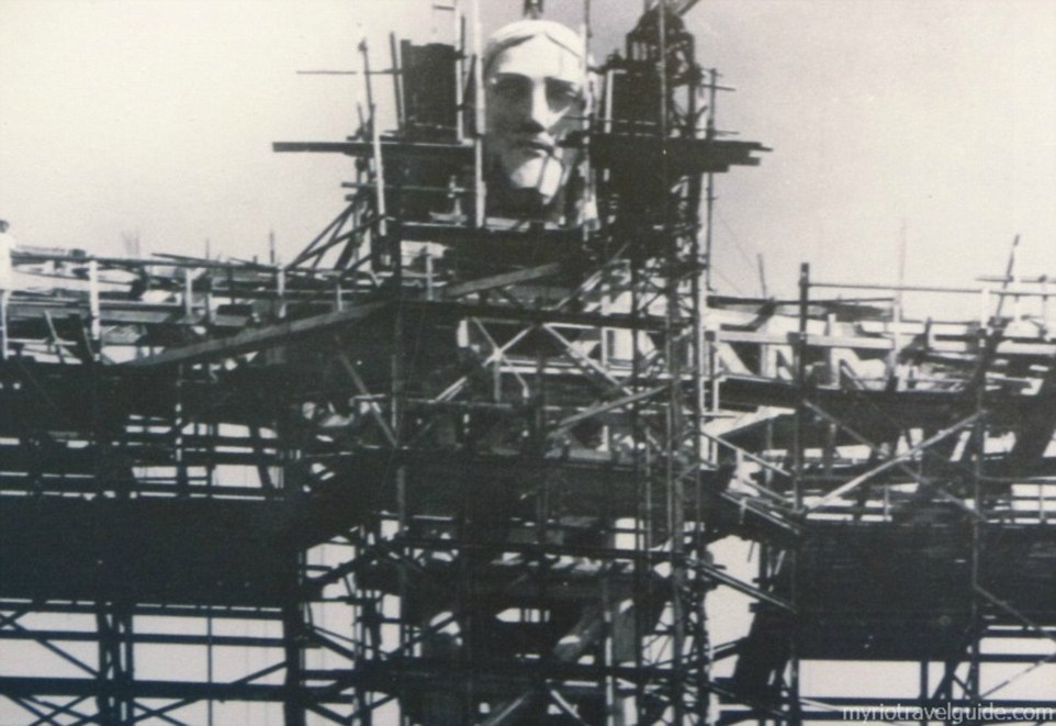 Only the face of Jesus Christ can be seen amid the scaffoldings as workers scramble to build the project atop the mountain