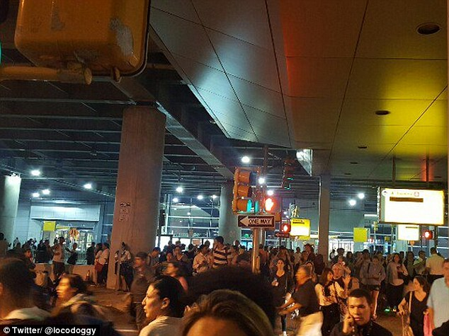 """'Police won't say anything except """"it's not safe to stay here"""" as we leave terminal 8,' one person wrote on Twitter"""