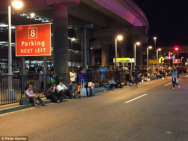 Passengers were left stranded on the street after the whole of Terminal 8 was evacuated