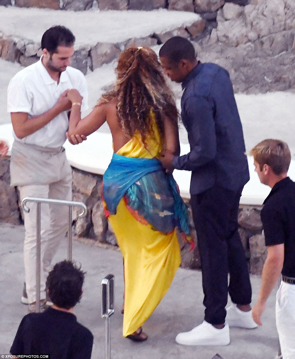 A hand: Wearing flip flops, the former Destiny's Child star made her way to the restaurant