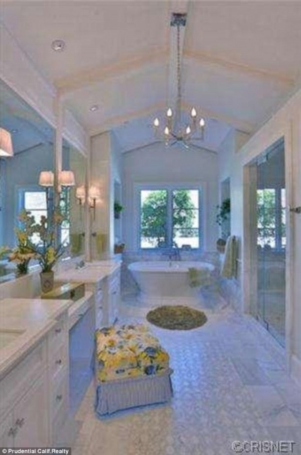 Tidying up: The spacious bathroom comes complete with his and hers sinks, bathtub and shower