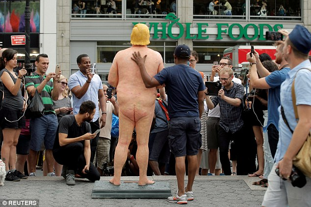 One of the naked Donald statues appeared in New York's bustling Union Square