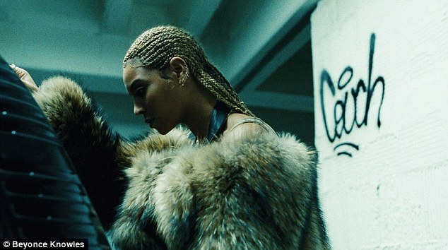 Pretty: She had her hair braided in another snap as she rocked a fur coat