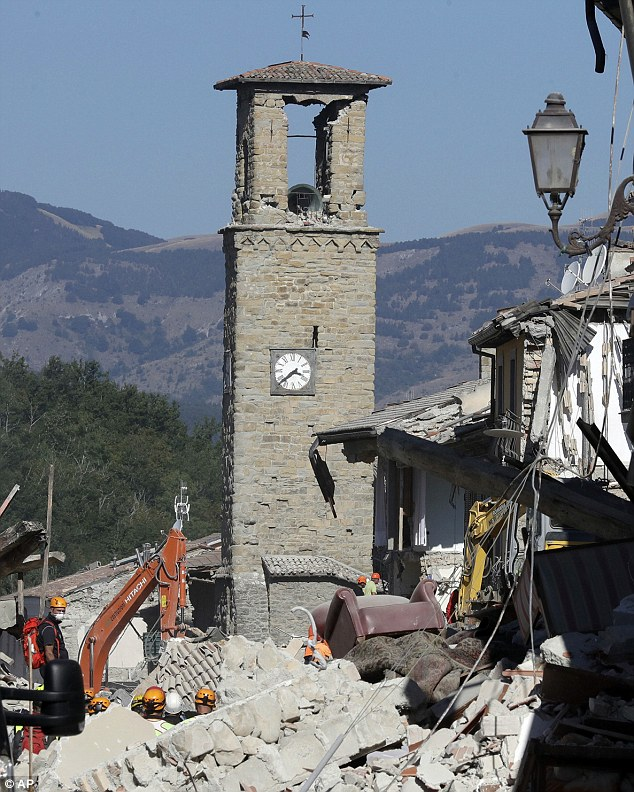Meanwhile the 13th century bell tower of Amatrice stood tall above the rubble over the surrounding buildings in Amatrice