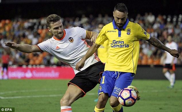 Shkodran Mustafi (left) fights for the ball for Valencia against Las Palmas on Monday night