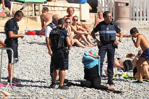 On Tuesday these photographs of four French police officers closing in on a woman who was wearing a headscarf on the Promenade des Anglais beach in Nice caused controversy