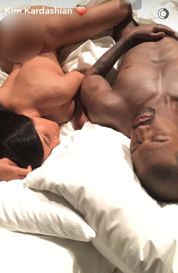 Side by side: The star showed off the wax replicas of herself laying beside her husband