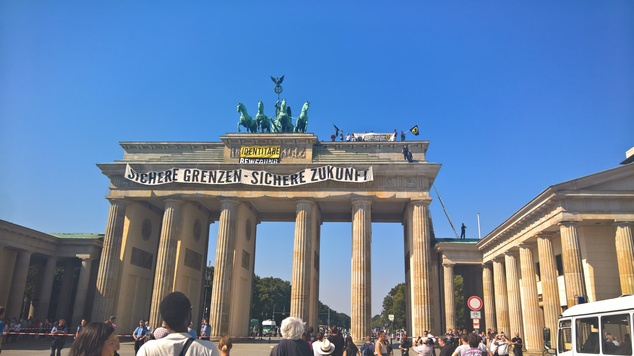 Anti-Islam activists have staged an hour-long demonstration atop Berlin¿s Brandenburg Gate Saturday Aug. 27, 2016. The protesters unfurled a banner calling f...