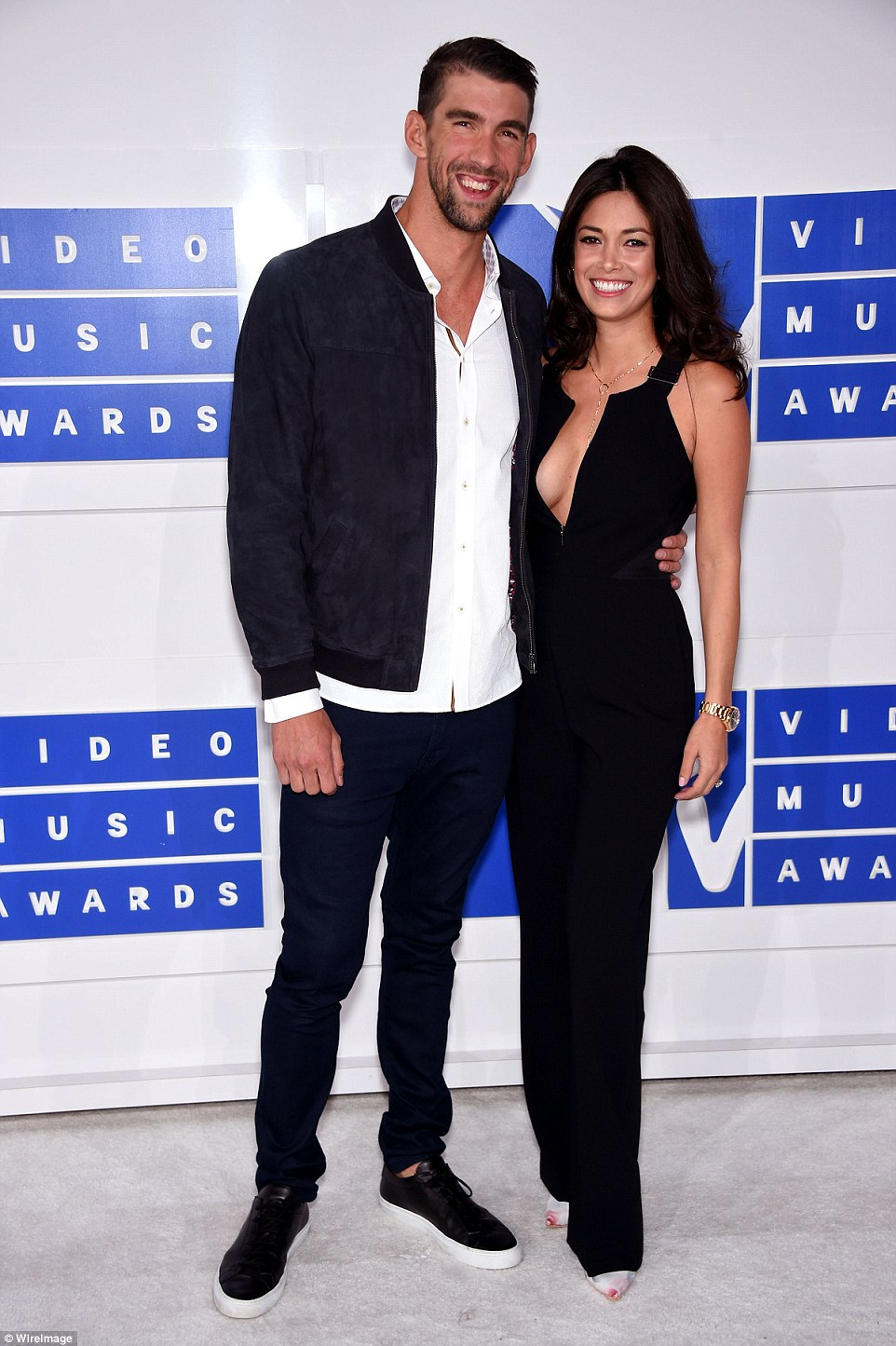 Loved up! Olympic swimmer Michael Phelps brought along fiancee Nicole Johnson