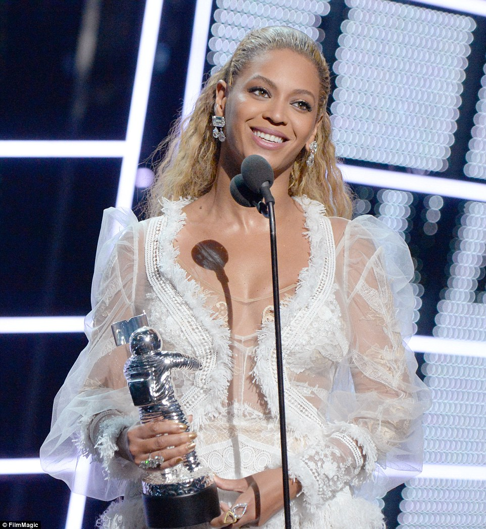 Family first: The 34-year-old singer accepted the biggest prize of the night as she began her speech by saying:'I'd like to thank my beautiful daughter and incredible husband for all of their support'