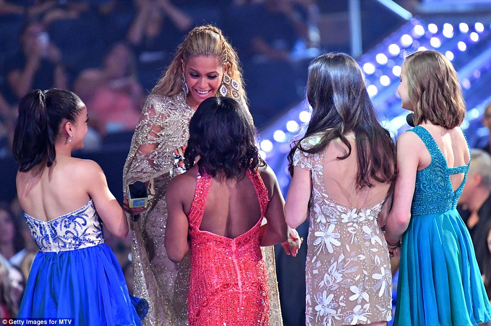Aww: The faces of Simone Biles, Aly Raisman, Madison Kocian and Laurie Hernandez all lit up as they hugged the  Lemonade hitmaker