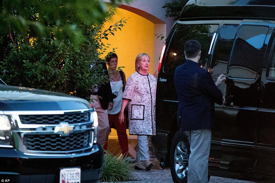 Not looking happy: The presidential hopeful seemed very serious as she headed to her van (above)
