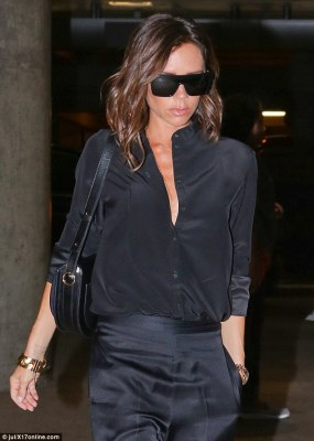 Chest a glimpse!Showing off her incredible figure, Victoria, 42, donned a plunging black blouse that she teamed with a delicate gold necklace, showing off her décolletage