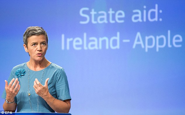 Damning: Competition commissioner Margrethe Vestager unveiled a 130-page report into Apple's Irish tax affairs today and said it allowed Apple to pay as little as 0.005% tax