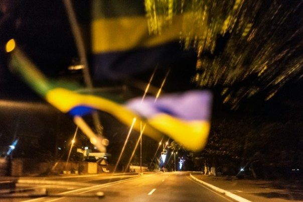 The Gabonese flag is reflected on the windscreen of a taxi driving through deserted streets of the capital Libreville on August 29, 2016, ahead of the procla...