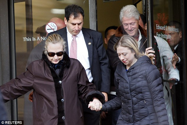 Clinton leaves New York Presbyterian Hospital accompanied by husband Bill and daughter Chelsea in January 2, 2013. She hadn't been seen in public since Dec. 7 and was receiving treatment  for a blood clot