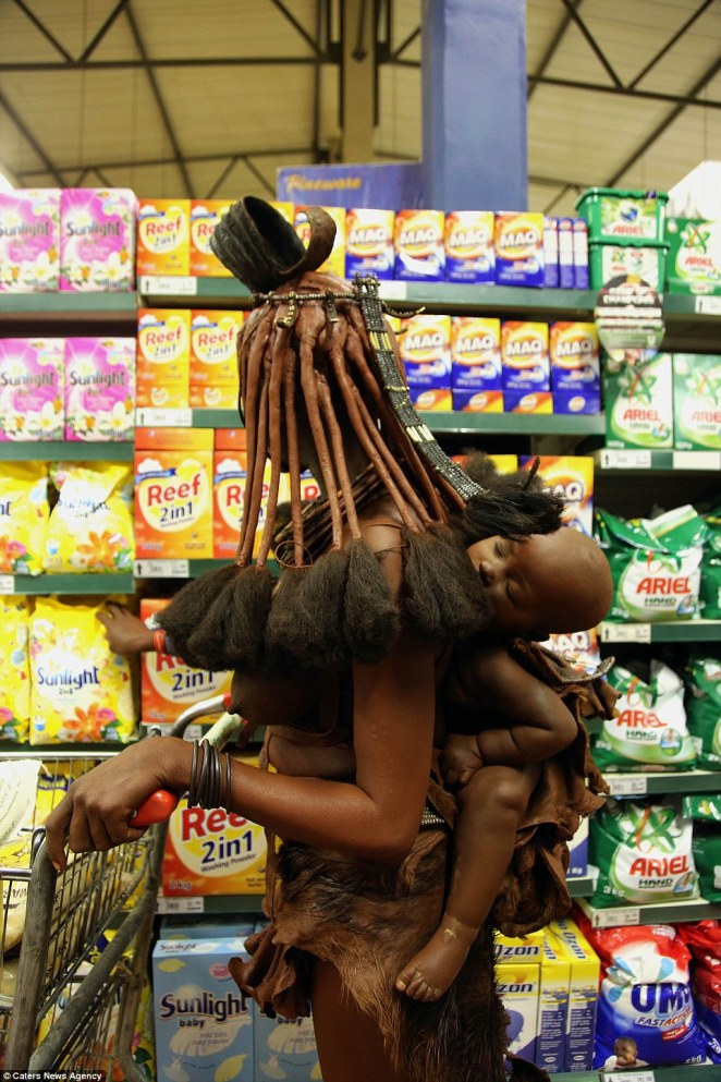 The woman carried a young child as she browsed the shelves of the supermarket inOpuwo, Namibia