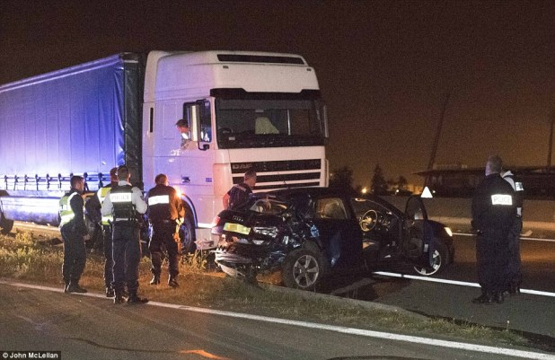 Migrants from the Calais Jungle camp are using a deadly new tactic in their attempts to get to Britain. Pictured, the MoS team's car crushed by a juggernaut