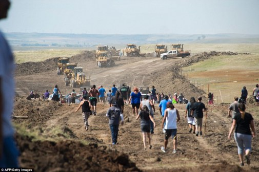 Protesters, pictured walking toward work being done on the pipeline, also fearthe Dakota Access Pipeline will pollute their water
