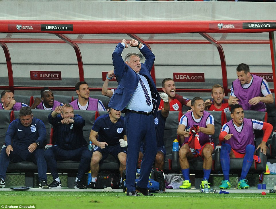 As Lallana's effort gives the Three Lions a 1-0 win against Slovakia in Trnava, new boss Allardyce holds his fists aloft