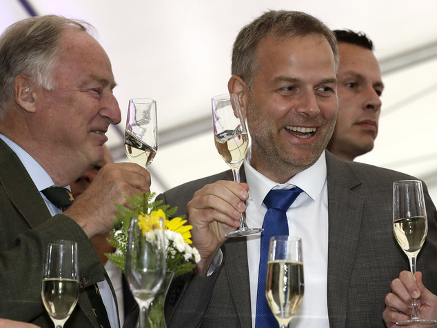 AfD member Alexander Gauland, left, and Leif-Erik Holm, top candidate of the AfD, toast at the gathering of the AfD (Alternative for Germany) party in Schwer...