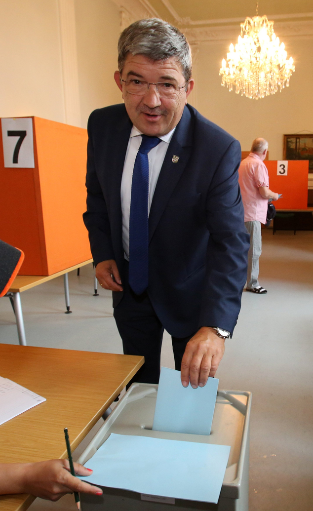 Top candidate  of chancellor Angela Merkel's Christian Democrats for the state elections in Mecklenburg-Western Pomerania, Lorenz Caffier, casts his vote in ...