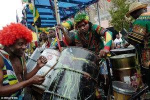 People on a parade float play music during J'Ouvert, ahead of the annual West Indian-American Carnival Day Parade in Brooklyn