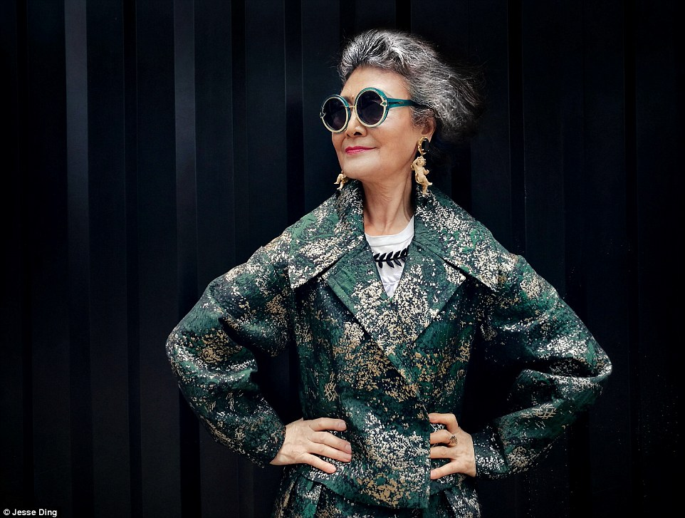 What style she has! She dons a green and metallic coat, teaming it up with large oval sunglasses and cherub earings
