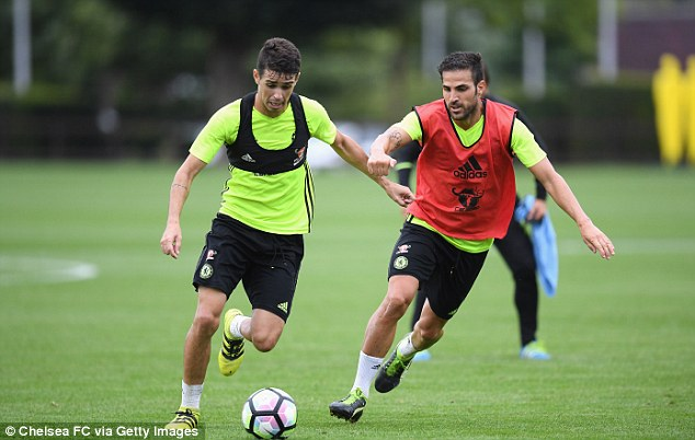 Fabregas battles Oscar for the ball and will hope to start against Swansea on Sunday
