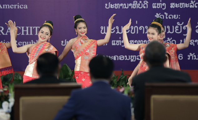 Laotian President Bounnhang Vorachit and U.S. President Barack Obama, right, watch a performance during an official state luncheon at the Presidential Palace...
