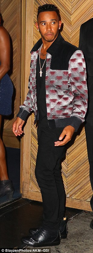 Low key:Lewis sported a colourful bomber jacket and black jeans for his evening out with the up and coming star
