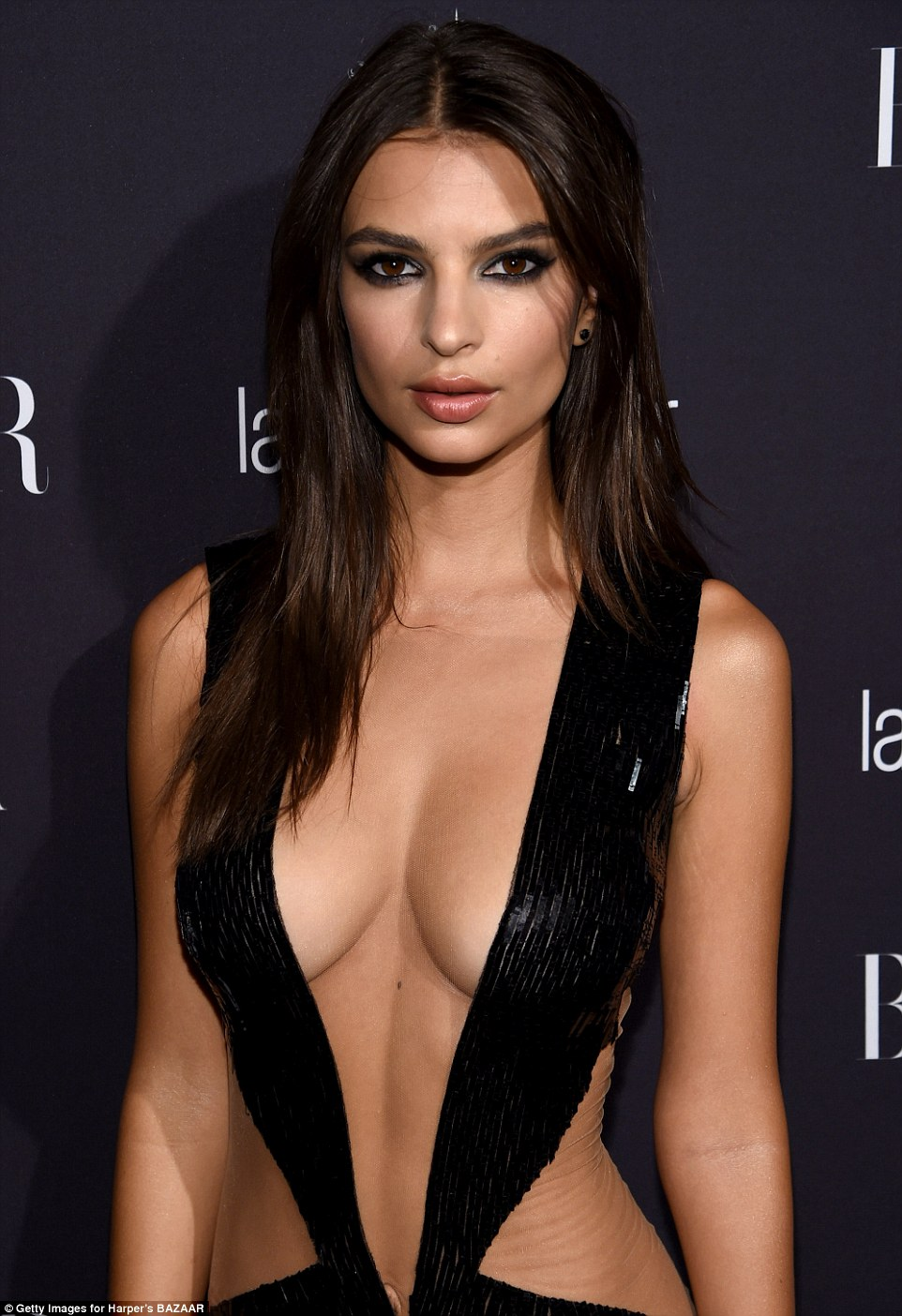 Provocative design: Emily Ratajkowski, 25, took the plunge in a sexy cut-out dress as she hit the black carpet at The Plaza Hotel for Carine Roitfeld's annual star-studded New York Fashion Week affair