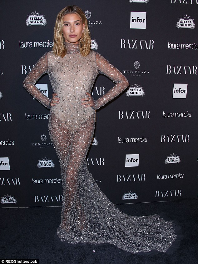 Hot metal: Hailey Baldwin stepped out in a stunning gown with sheer skirt and train at the Harper's Bazaar celebration of Icons party in New York City