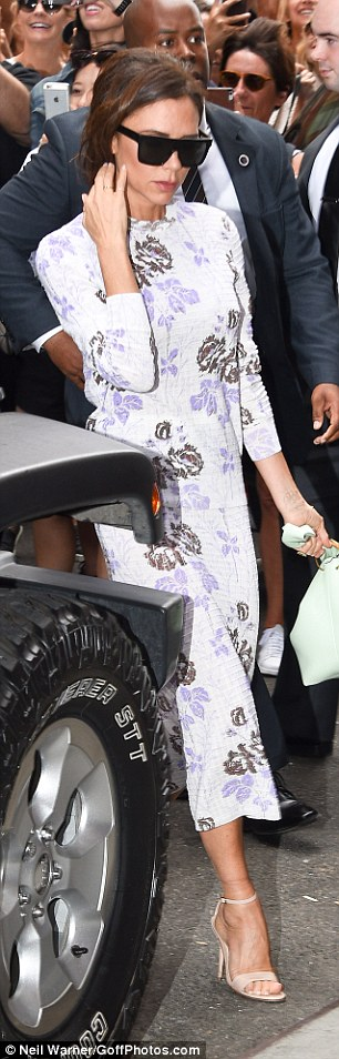 Summery: Victoria's dress was from her upcoming collection and she teamed it with a pair of nude sandals