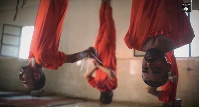 Sickening footage shows men hanging upside down by their feet from meat hooks while they await execution