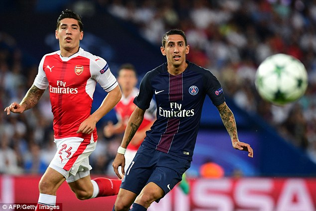 Bellerin keeps his eye on the ball whilst keeping tabs on PSG playmaker Angel di Maria