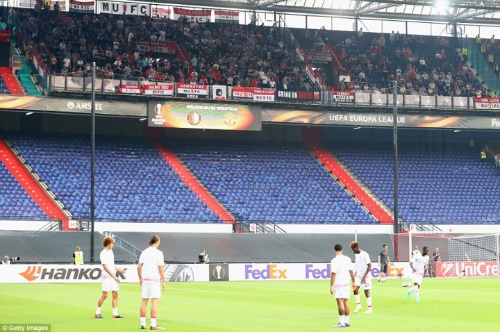 The game in Rotterdam was played in a half-empty stadium after Feyenoord were punished for crowd trouble last season
