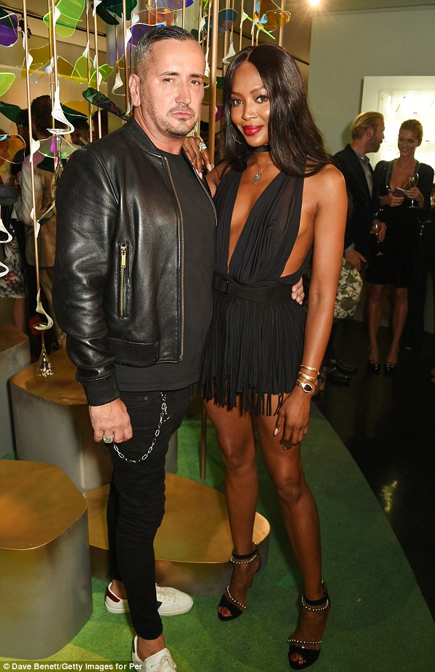 Style queen: Naomi's thigh-skimming dress had a tasselled skirt and a black belt secured it around her waist