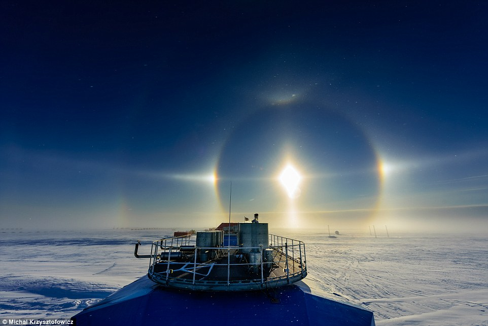 Other-worldly: Scientist Michal Krzysztofowicz, who works for the British Antarctic Survey  in Antarctica, says 'this solar phenomenon was caused by diamond dust, where ice particles  cause the light to refract into a halo'