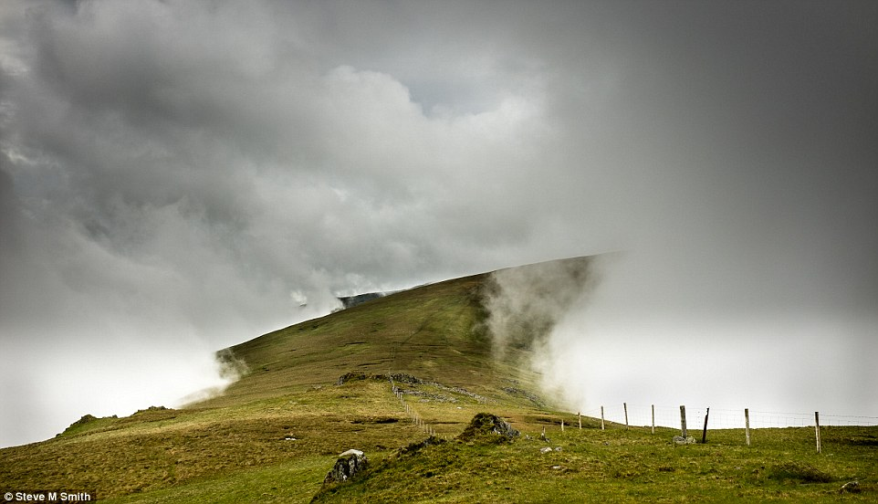 Apparition: Steve M Smith took this photo in North Wales. He says: 'On the hills we were shrouded until late morning when a clear way emerged along the ridge towards Foel Fras in the Carneddau'