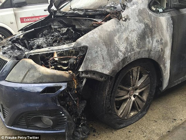 Frauke Petry, leader of Alternative for Germany (AfD), posted this photo on Twitter with the caption: 'An arson attack was committed on my car yesterday. Is this what we have come to'