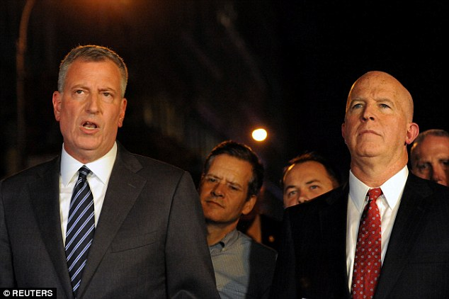 New York Mayor Bill de Blasio (left) and Police Commissioner James O'Neill hold a news conference near the site of an explosion in the Chelsea section of Manhattan